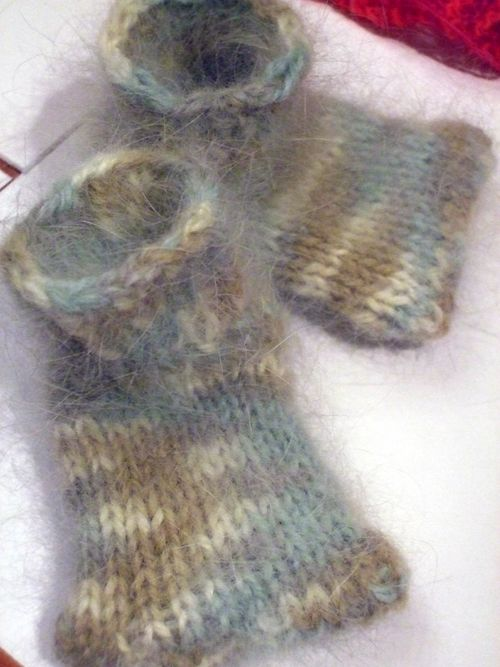 Booties from Last-Minute Knitted Gifts knit with angora yarn.